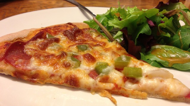 Turkey pepperoni, mozzarella cheese, onion, green peppers, and the pizza dough even used whole wheat flour. Delicious!
